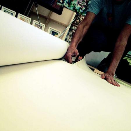 artist cutting canvas