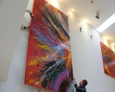 Hanging a very large canvas painting
