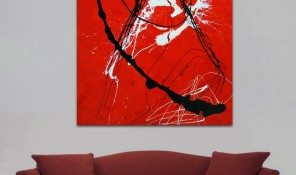 Red sofa and canvas paintings