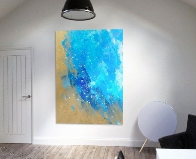 Blue and metallic gold art on a white wall