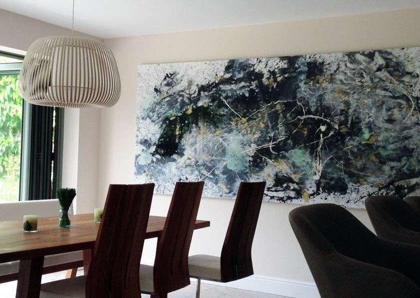 tall modern art in a tall living space