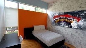 bedroom with abstract modern art