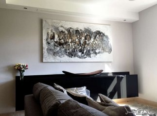 Black and white abstract art in a living room