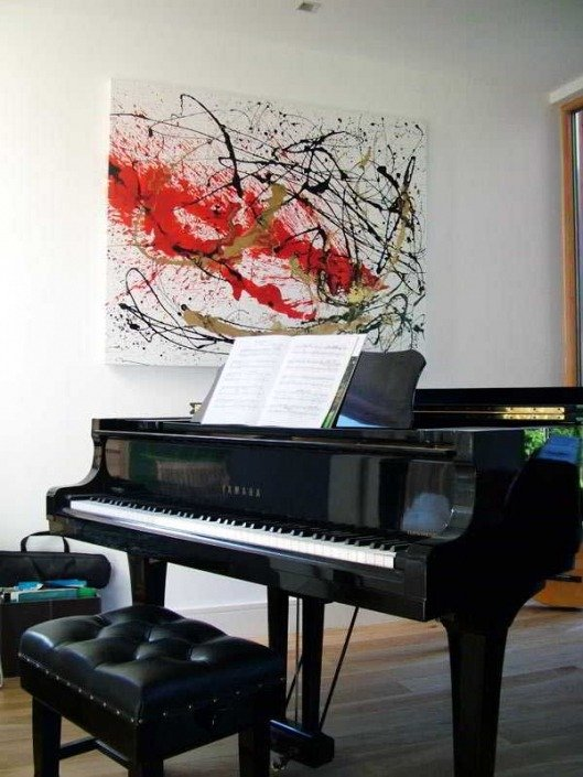 A Piano and art on a wall