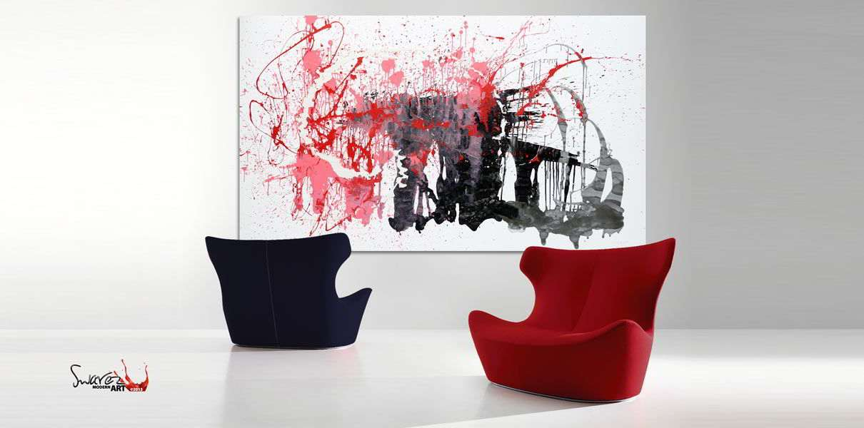 Red and black art behind two contemporary chairs