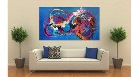cream leather sofa and art