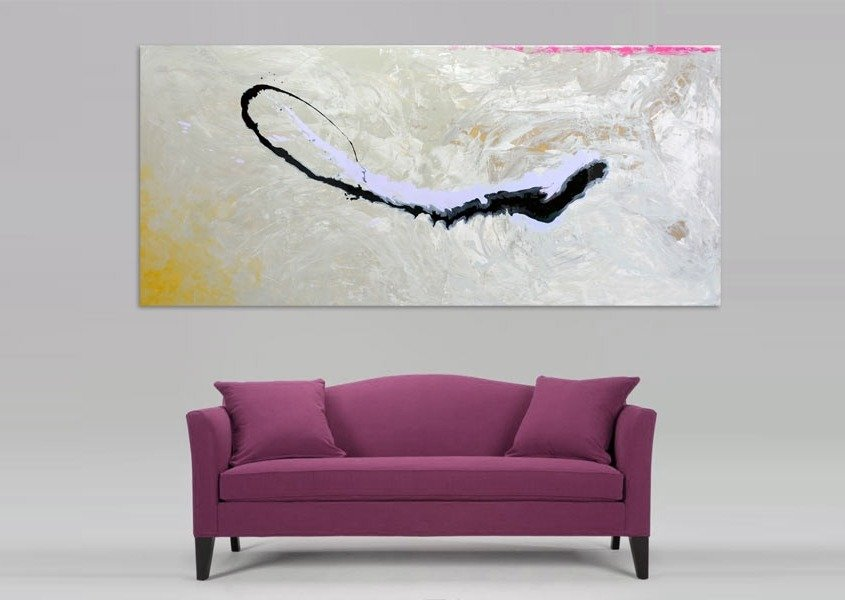 dark pink sofa with a painting