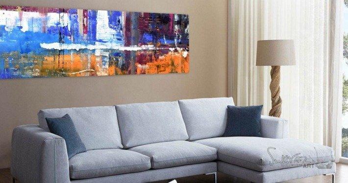 Art hanging above a sofa