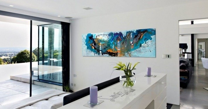 Long shaped blue painting in a bedroom
