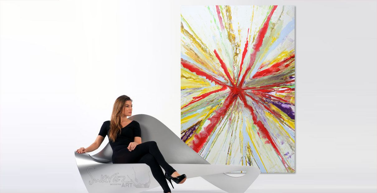 A painting and a chair in a modern room