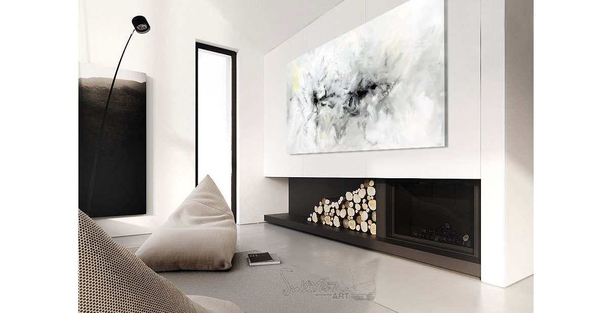 A piece of art hanging above a wood burner