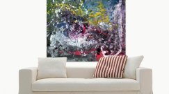 Big multi-coloured art above a beige sofa