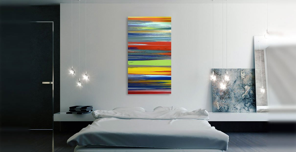 Multi-coloured striped art in a bedroom
