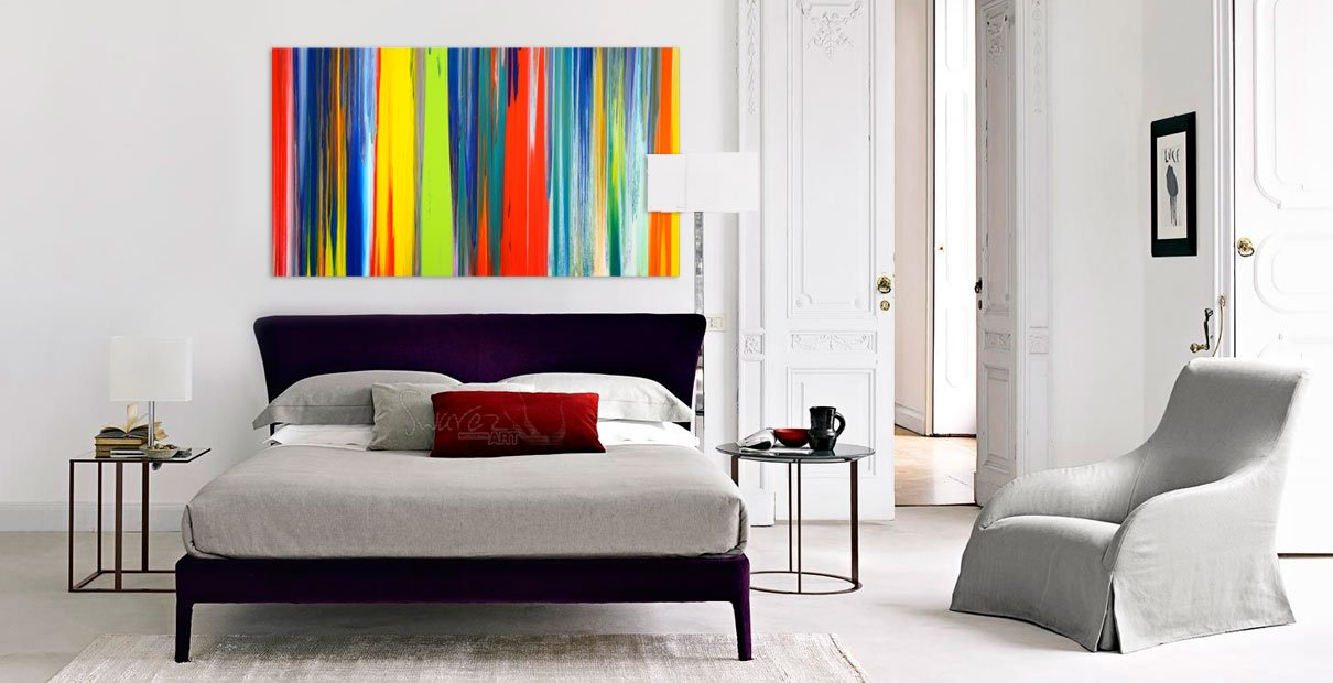 Multi-coloured striped art above a bed