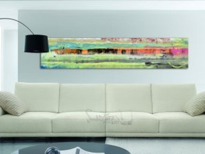 Long piece of art above a white coloured sofa