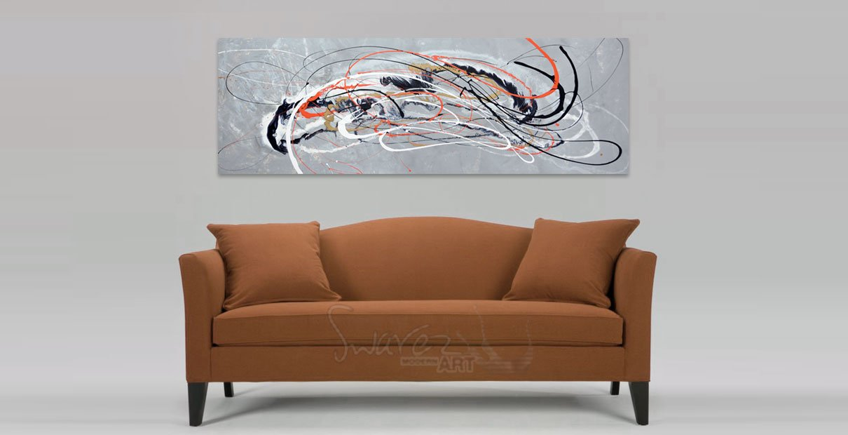silver art and brown sofa