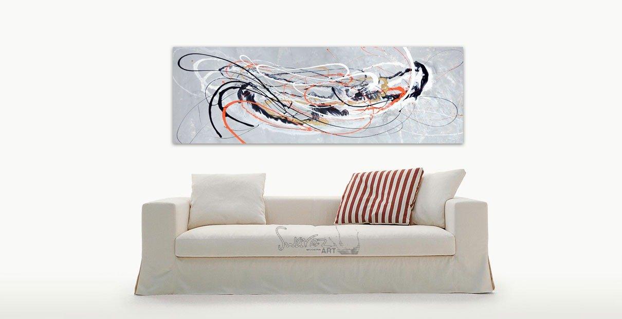 Orange and silver art and white sofa