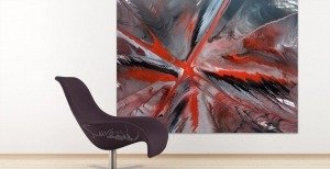 Red, black and grey painting behind a large chair