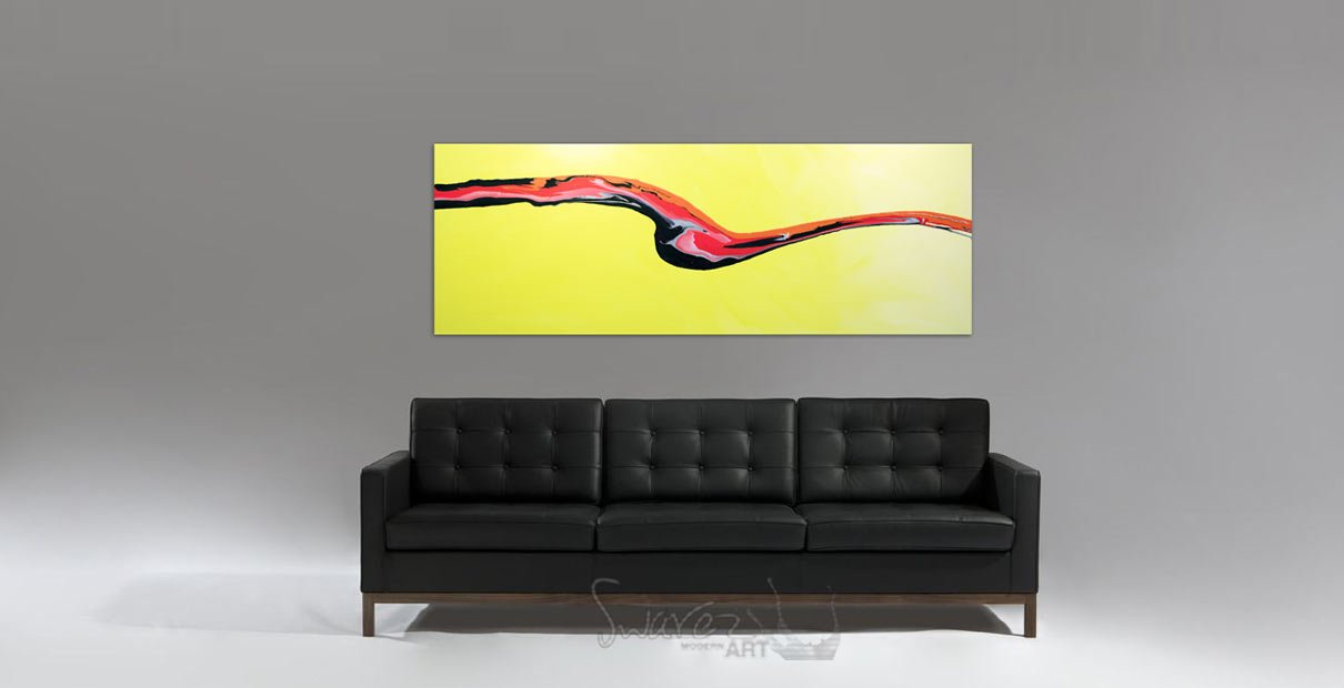 Yellow-art-hanging-above-a-black-leather-sofa