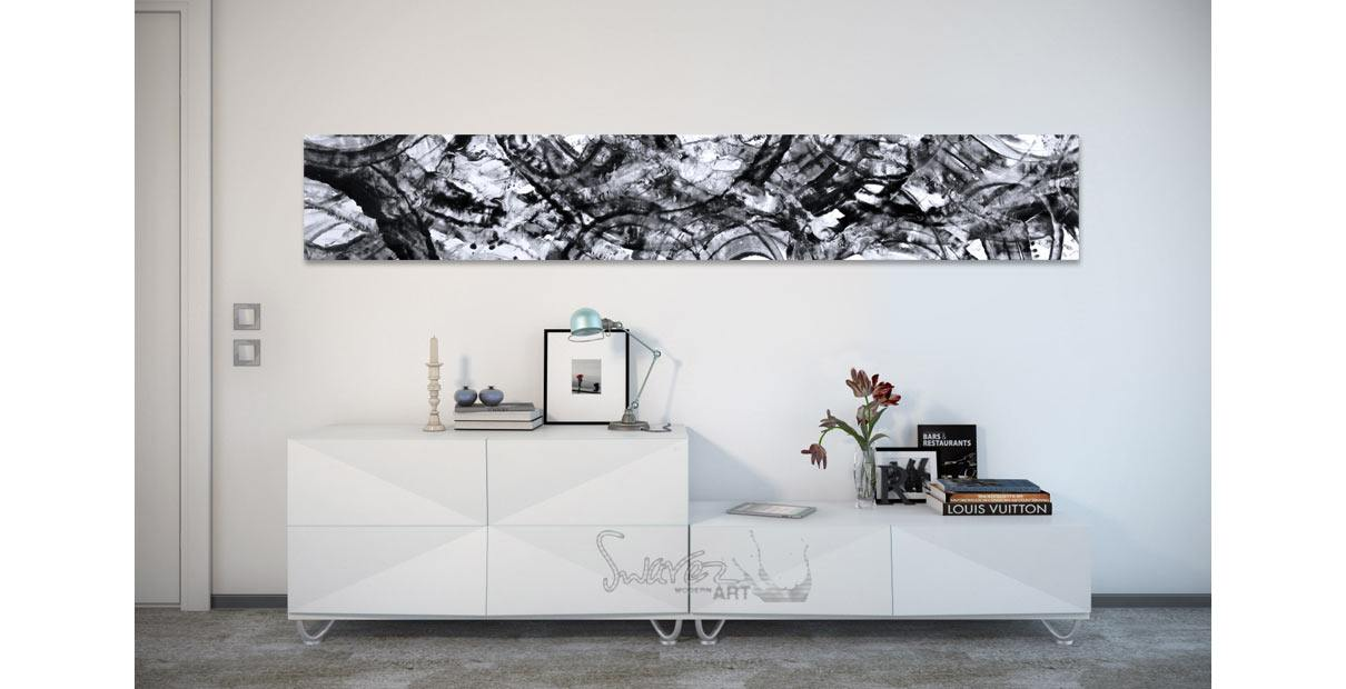 Black and white painting above a console