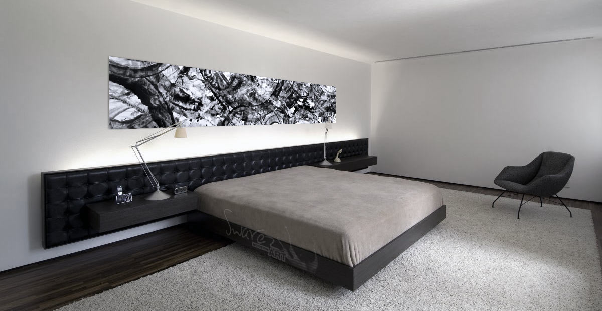 Monochrome painting hanging above a bed