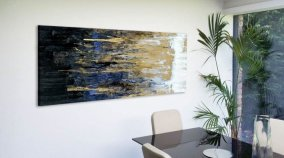 Gold and blue painting in a dining room