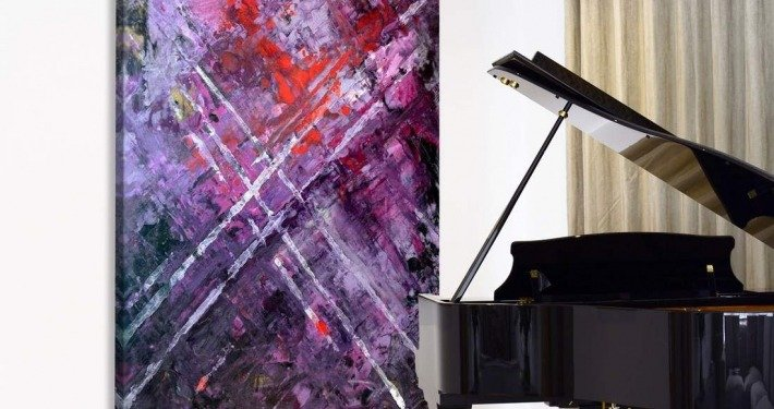 large purple painting by piano