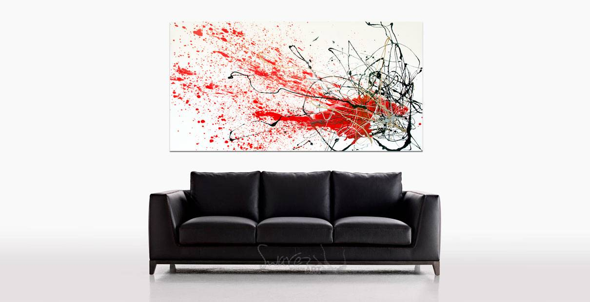 Big original art above a black sofa