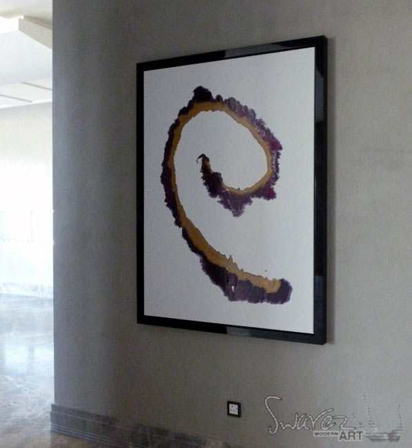 Mimimal purple and gold art in a black frame