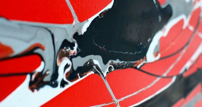 Close up of In Constant Motion, a red and black original painting