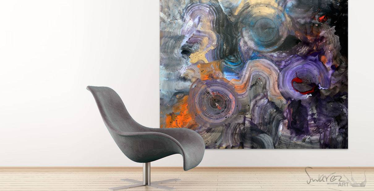 Grey curved chair in front of a large abstract painting