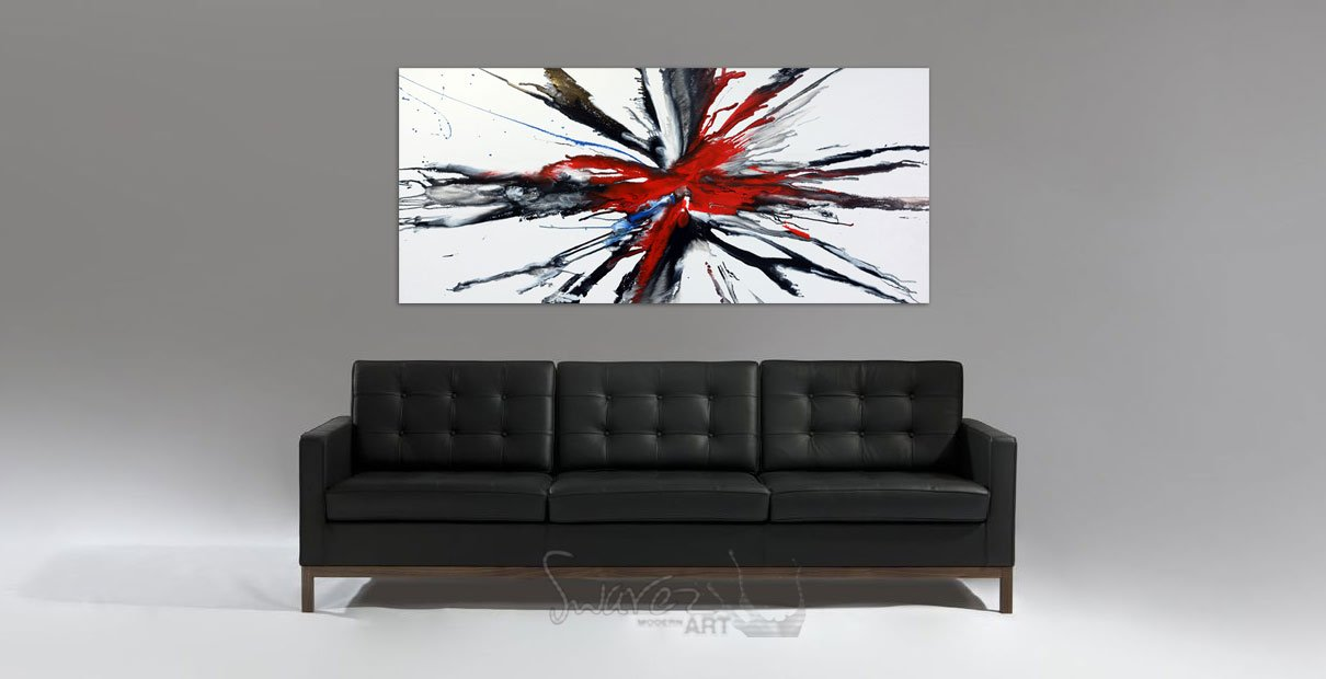 A piece of black and white art above a black leather sofa