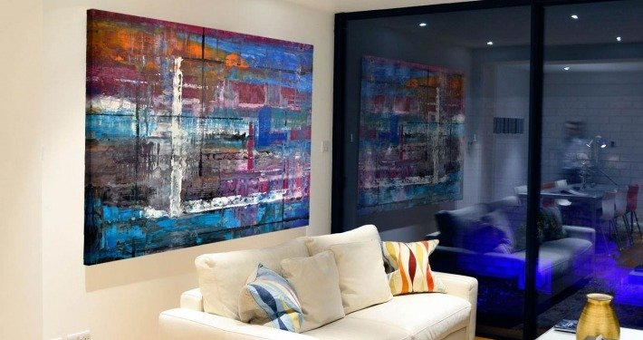 Blue painting with lines in a living room
