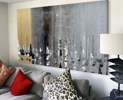 Gold-and-silver-painting-above-a-grey-sofa