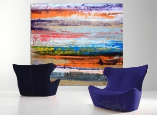 Purple and blue designer chairs with art hanging behind