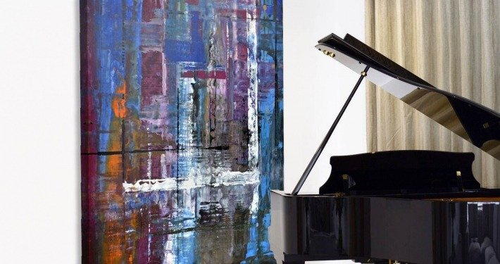 Piano with a large blue art work behind it
