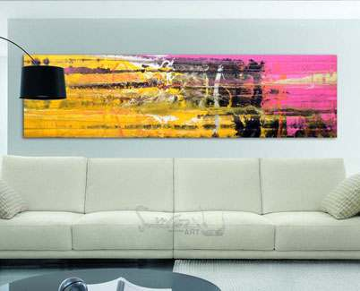 Pink-and-yellow-painting-hanging-in-a-wall