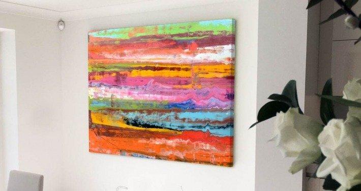Rainbow art on a kitchen wall