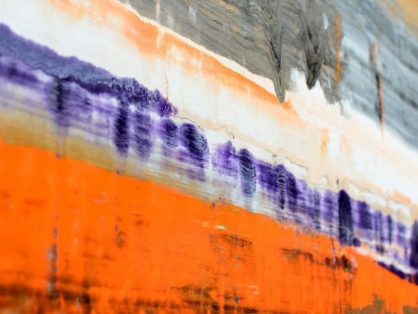 Purple and white and orange lines of paint