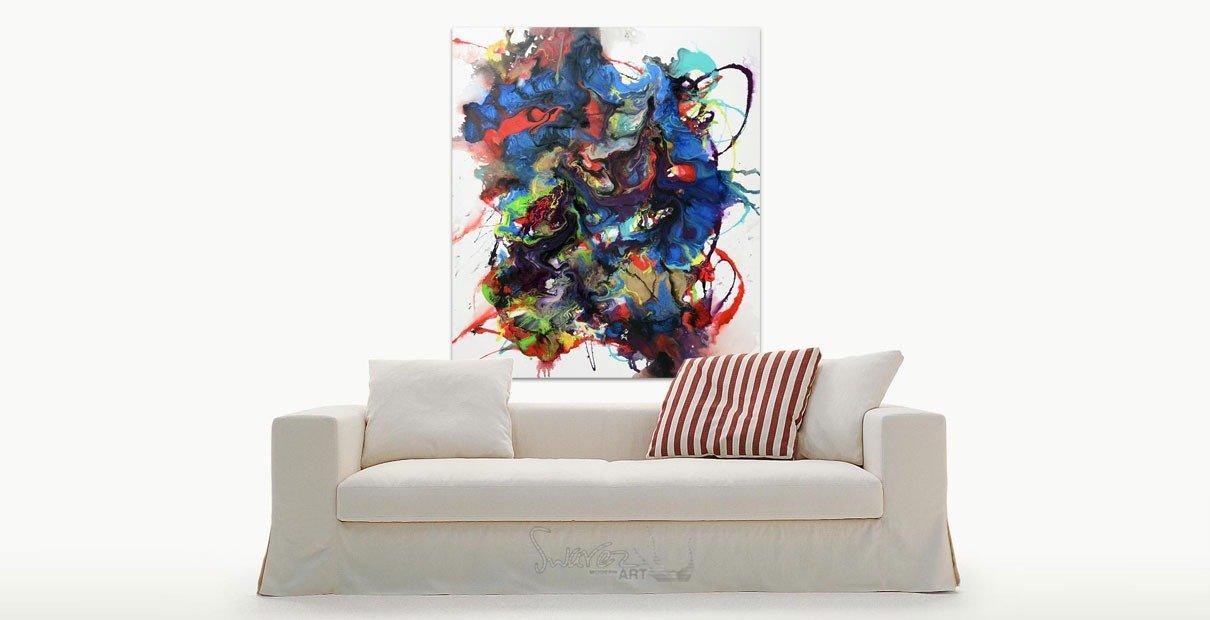 Art hanging above a cream sofa