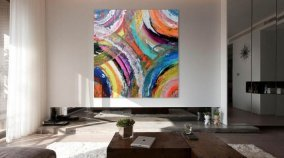 Large rainbow art in a living room
