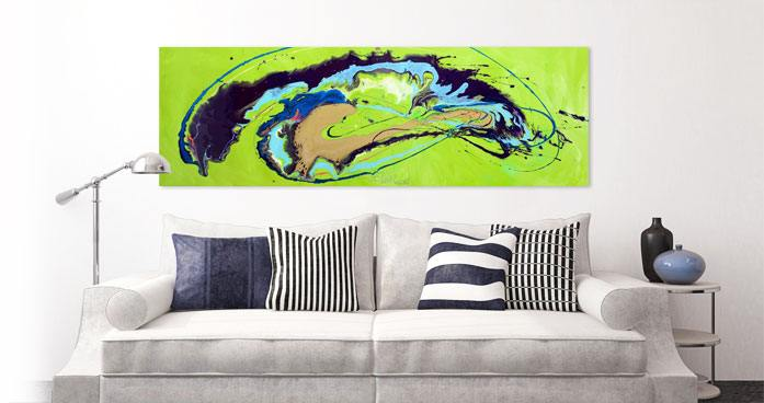 Lime green and blue painting above a cream sofa