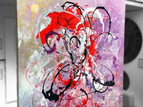 Medium sized original red and purple art on a stand