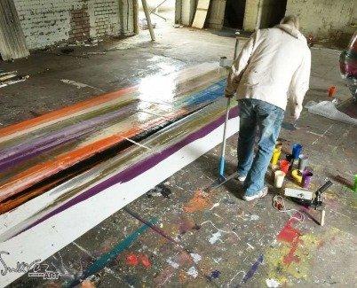 Art studio with canvas on the floor