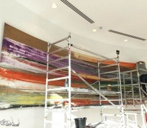 Assembling a 20ft curved painting with scaffolding
