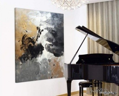 Grand piano with art hanging behind it