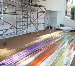 Canvas art laid on a floor