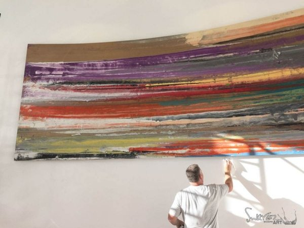 Cleaning a large canvas painting