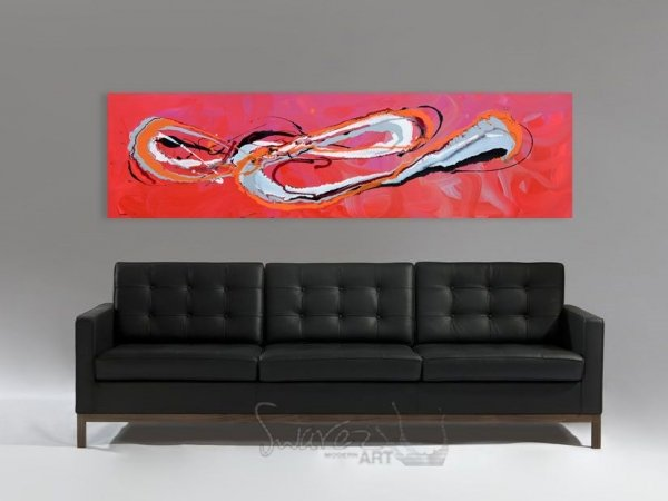 Red and pink painting and a black leather sofa