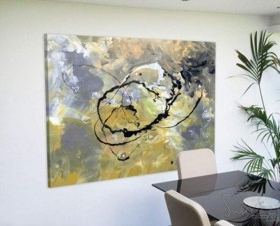 Abstract art above a dining table